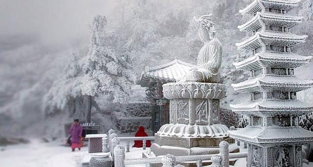 Snow blankets a temple on a mountain in South Korea's eastern Gangwon Province