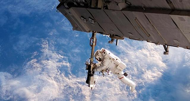 Space walk outside of the International Space Station