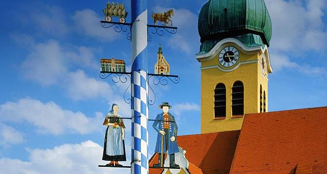 Maypole in front of a church in Wolnzach, Bavaria, Germany