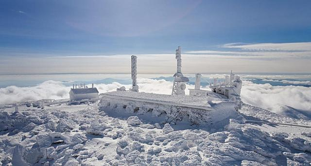 The Mount Washington Observatory, completely covered in hard rime ice, on the summit of mount Washington, New Hampshire