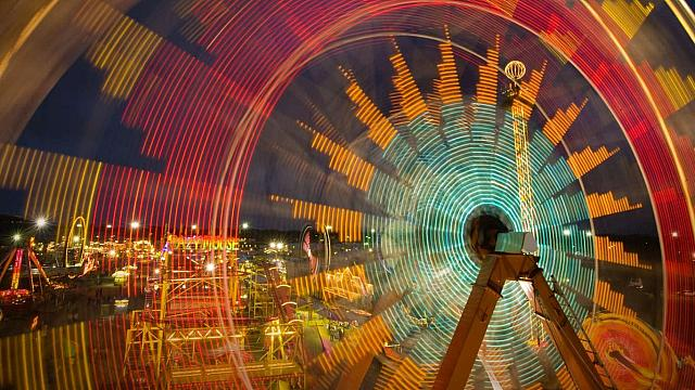Spinning carnival rides at the Kansas State Fair in Hutchinson, Kansas (© Joel Sartore)