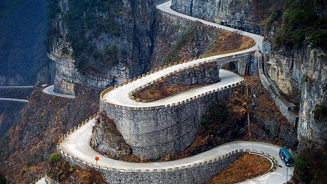 A bus descends the serpentine turns of  Tongtian Avenue on Tianmen Mountain near Zhangjiajie, Hunan Province, China (© Tom Horton/Getty Images)