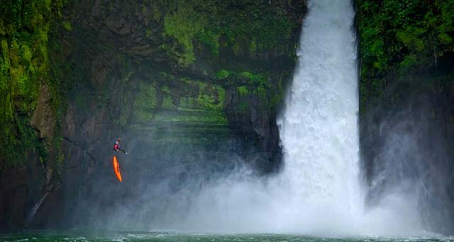 A man rappels down a huge cliff next to a waterfall on the Rio Alseseca in the state of Veracruz, Mexico
