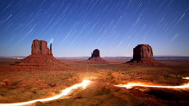 Time-lapse of night sky and lights in Monument Valley Navajo Tribal Park, Utah (© Duncan Frazier)