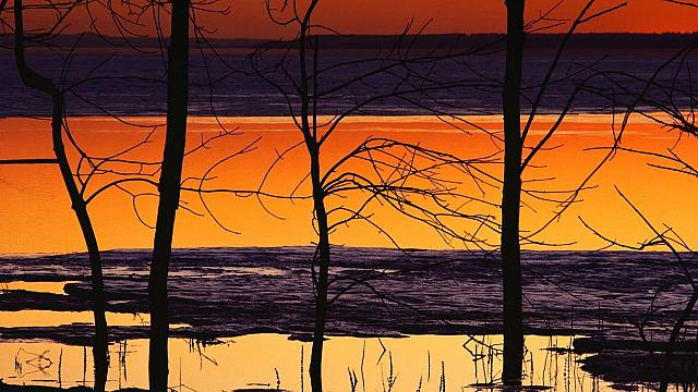 Reflections on a lake at sunset (© Corbis/age fotostock)