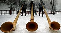 Three alphorn players from the International Alphorn Society perform in Fort Kent, Maine