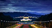 View from the Australian War Memorial down Anzac Parade toward the New and Old Parliament Houses in Canberra, Australia