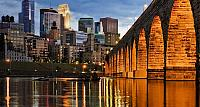 Minneapolis skyline and Stone Arch Bridge over the Mississippi River, Minnesota