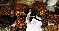 An Emirati man shopping at a market before the first day of Ramadan