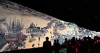 "Visitors view the dynamic version of the famous Chinese picture ""Riverside Scence at Qingming Festival"" at the China P"