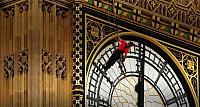 "Workers carry out repairs to the clock faces on St Stephen's Tower – commonly called  ""Big Ben"" – in London, England"
