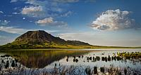 Bear Butte reflects into Bear Butte Lake near Sturgis, South Dakota
