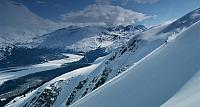 Skier making turns on a ridge near Valdez, Alaska