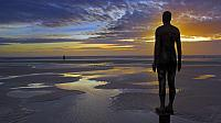 """Another Place"" statues by artist Antony Gormley on Crosby Beach, Merseyside, England (© Neale Clarke)"