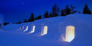 Illuminated igloo, Kakslauttanen, Lapland, Finland (© Arctic-Images/Iconica/Getty Images)