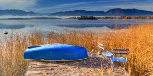 Blue rowboat, Lake Staffelsee, Bavaria, Germany (© Frank Lukasseck/Corbis)