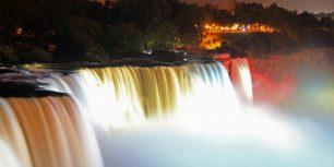 Illuminated American Falls, part of Niagara Falls, seen from the Prospect Point Park observation tower in Niagara Falls, New York (© Prasad Karkera)