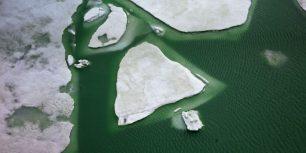 Ice on Lake Grimsel, Switzerland (© Gozooma/Gallery Stock)