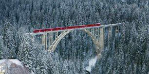 Rhaetian railway passing through Langwieser Viaduct bridge, Switzerland (© Werner Dieterich/Corbis)