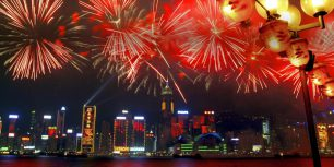 Fireworks in Victoria Harbour during the Chinese new year, Hong Kong, China (© Fumio Okada/age fotostock)