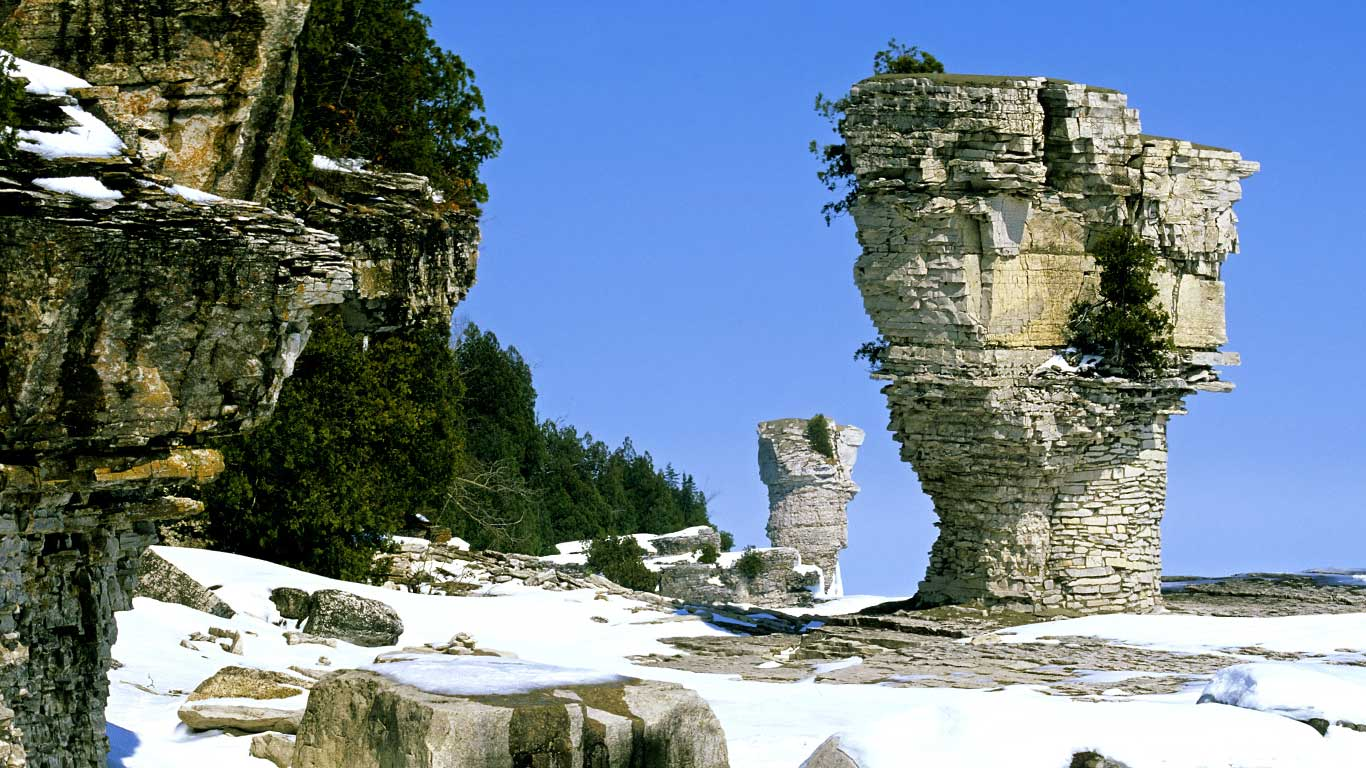 The famous flowerpots, eroded limestone formations, located on the shoreline of Flowerpot Island, Georgian Bay, in Fathom Five National Marine Park, Ontario (© Ethan Meleg/All Canada Photos/Getty Images)