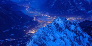 View over Waxenstein crest on illuminated town of Garmisch, Bavaria, Germany (© Olaf Broders Nature Photography/Getty Images)