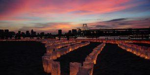 Candles line the beach at Odaiba Marine Park for Marine Day, Tokyo, Japan (© KeystoneUSA-ZUMA/Rex Features)