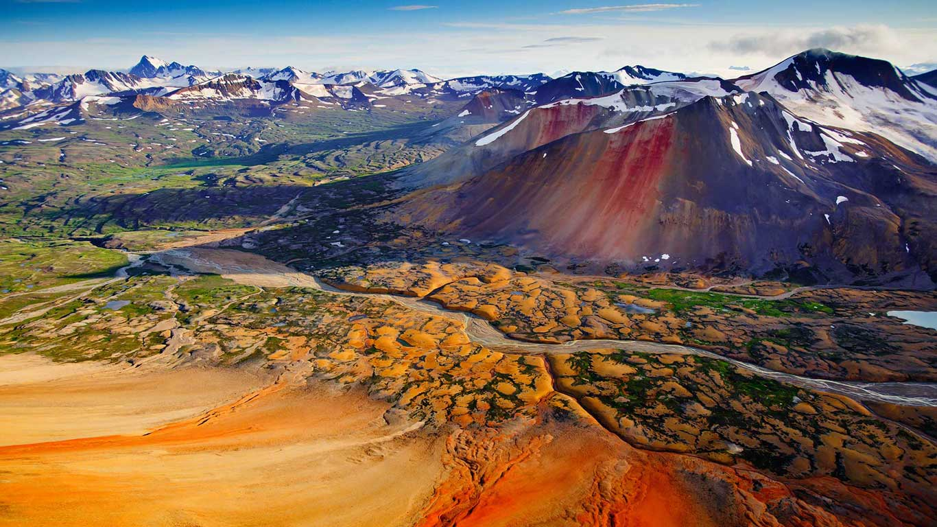 Mineral-heavy peaks, Spectrum Range, Mount Edziza Provincial Park, British Columbia, Canada (© Carr Clifton/Minden Pictures)