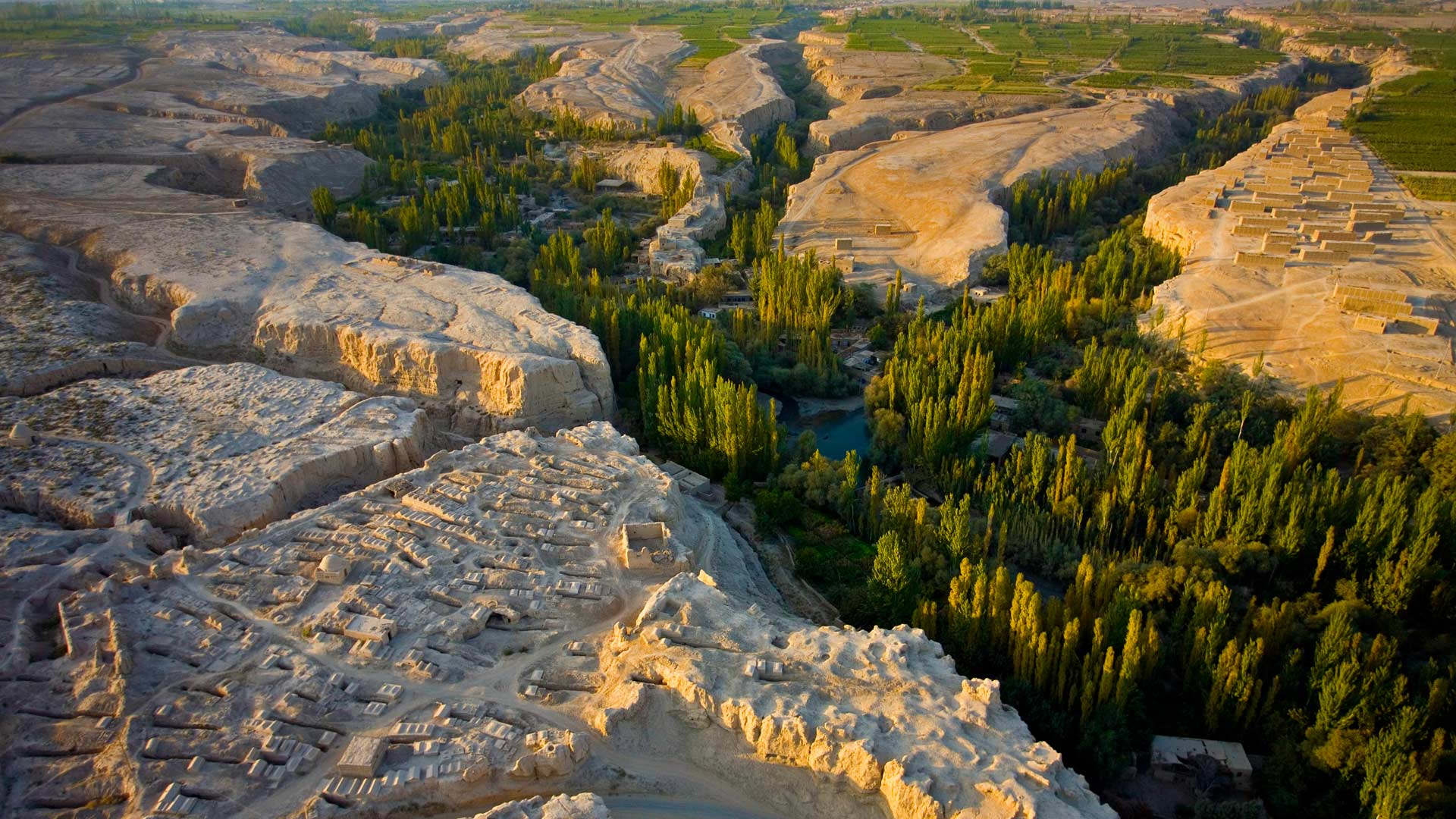 A cemetery overlooking the river gorge in the Turpan Depression, Xinjiang, China (© George Steinmetz/Corbis)