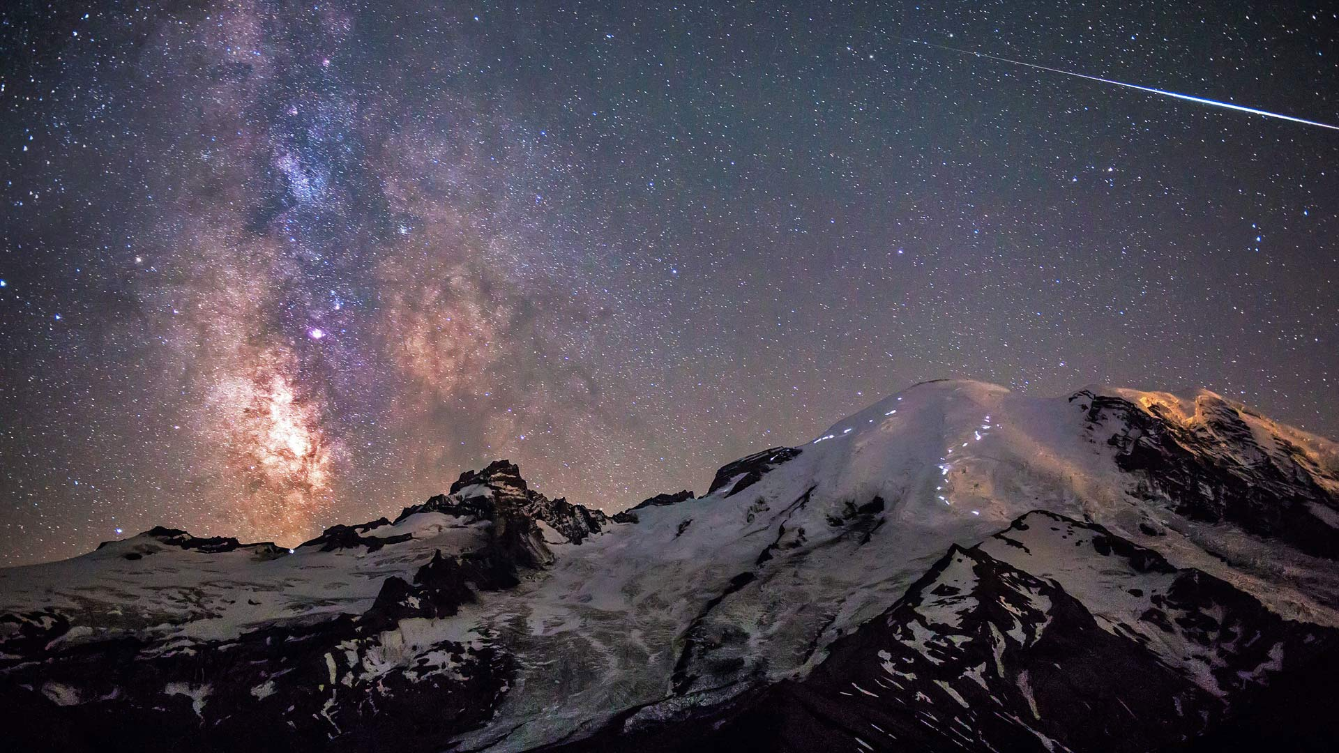 Milky Way above Mount Rainier in Mount Rainier National Park, Washington (© Brad Goldpaint/Aurora Photos)