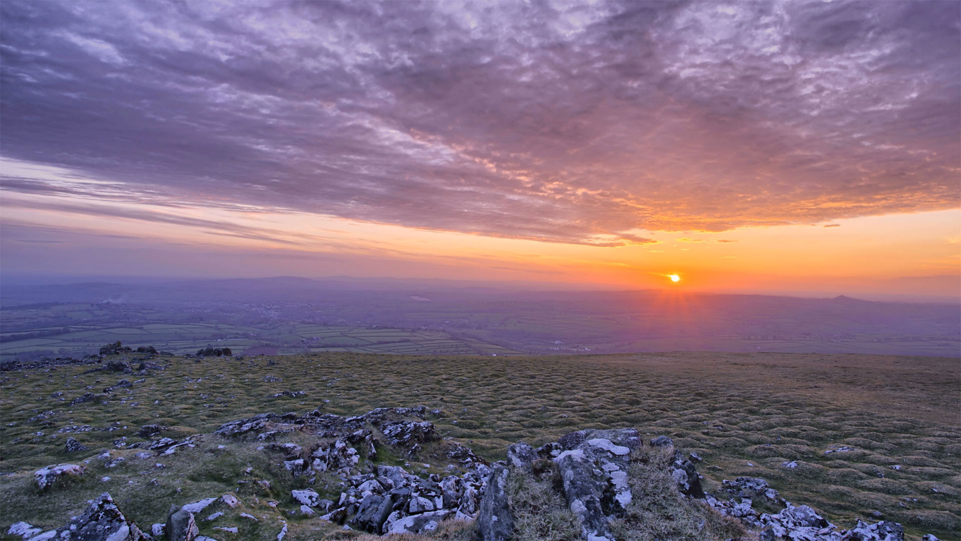 Sun setting in Dartmoor National Park, Devon, England