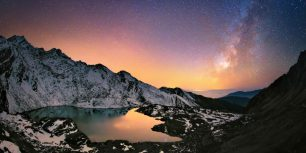Nepal's Gosaikunda Lake in the Himalayas and the Milky Way above  (© jankovoy/Getty Images)