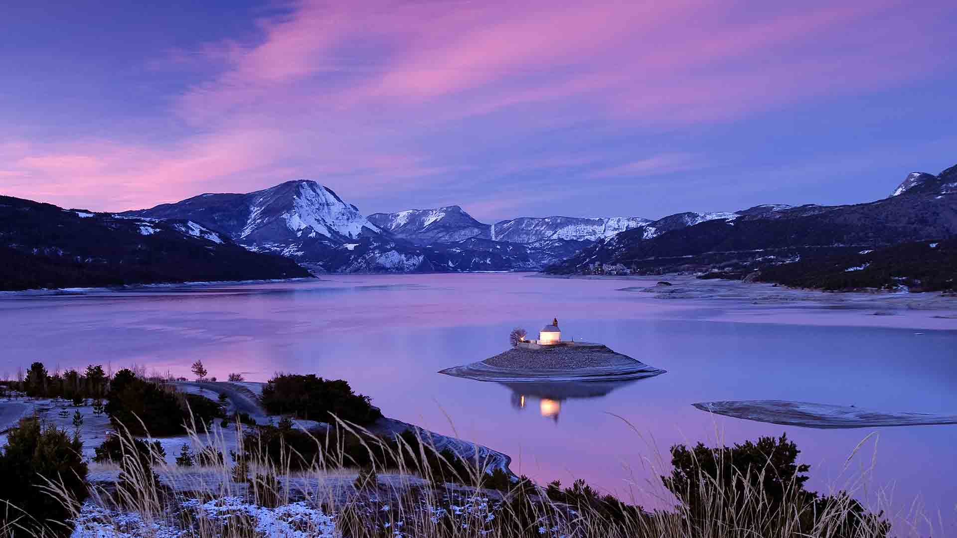 Chapel of St Michel on Lake Serre-Ponçon, Hautes-Alpes, France (© Hemis/SuperStock)