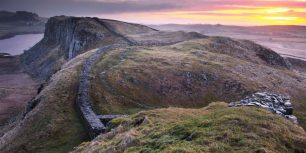 Sunrise over Hadrian's Wall at Steel Rigg in Northumberland, England (© Graeme Campbell/Getty Images)