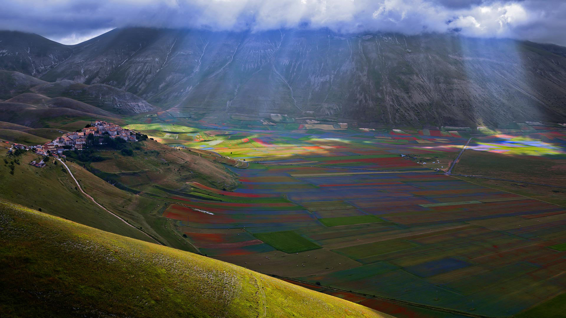 The village of Castelluccio above the Piano Grande, Umbria, Italy (© beppeverge/Getty Images)