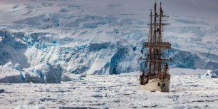 The Europa sails the Penola Strait, Antarctic Peninsula, Antarctica (© Colin Monteath/Minden Pictures)